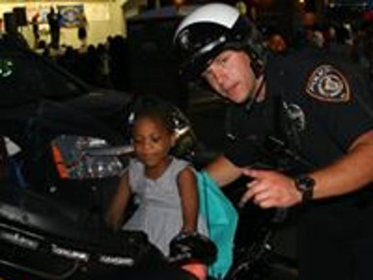 A Piscataway police officer interacts with a young