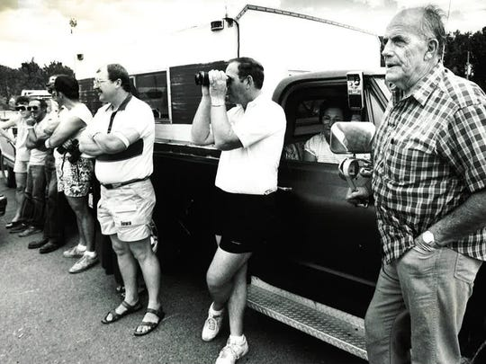 Sheriff Jim Black and supporters watch from a distance as Debbie Duz Donuts opens on July 29, 1989.