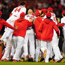 Sept. 18: Cardinals catcher Tony Cruz is mobbed by teammates after hitting a walk-off single during the 13th inning against the Brewers.