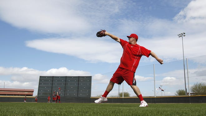 Reds right fielder Jay Bruce long tosses with other position players during Spring Training, Sunday.