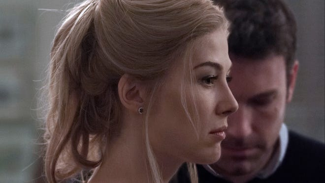 "Rosamund Pike portrays Amy Dunne, whose mysterious disappearance turns her husband, portrayed by Ben Affleck, into a possible murder suspect in ""Gone Girl."""
