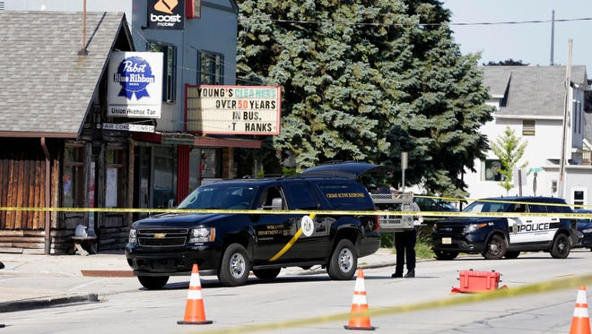 State investigators gather and process evidence at the shooting scene at the Union Avenue Tap Monday July 18, 2016 in Sheboygan.