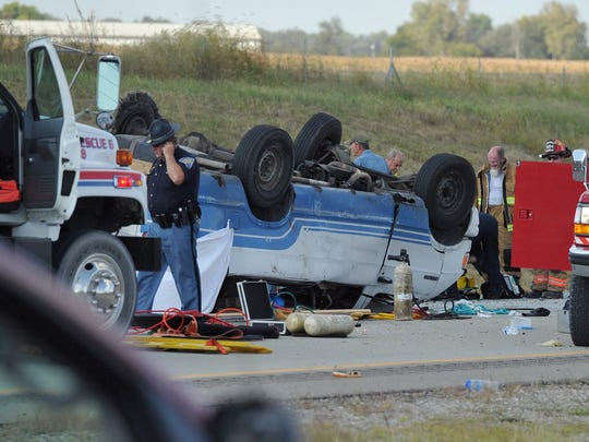 Emergency crews respond to numerous injuries after at least one person died in a rollover crash on Interstate 69 in Gibson County just north of the Fort Branch/Mackey exit, according to the Gibson County Sheriff's office.  One van had a tire blowout in the crash.  More than 10 were injured, according to the Indiana State Police.