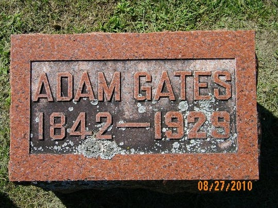 "Adam Goetz's gravestone in the St. Michael Cemetery, in the town of Mitchell. His last name was Americanized to ""Gates."""