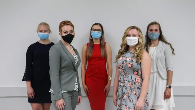 Contestants in this year's Lenawee County Fair Queen's Pageant, practiced certain safety measures such as wearing face masks when in public. The annual queen's pageant was held virtually this summer because of the coronavirus pandemic. Contestants pictured are, from left, Rylee Clairday (runner-up), Amy Shaffer, Allie Bretz, Grace Jennings and Grace Francoeur (fair queen).
