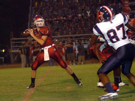 Pineville's Christian Adams (9) looks for a receiver in a 2012 game against West Monroe.