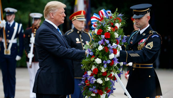 President Donald Trump lays a wreath during a Memorial Day ceremony at Arlington National Cemetery May 28, 2018, in Arlington, Va.