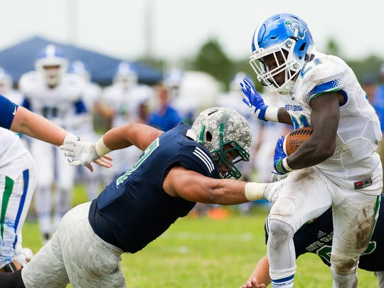 West Florida's Daviante Sayles(21) avoids a tackle during a game against Ave Maria on Saturday, Sept. 3, 2016.