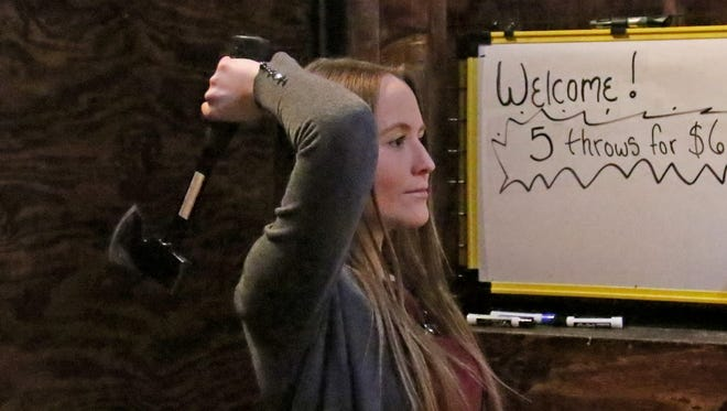 Now New Group Reporter Hannah Kirby tries the one-hand throw, one of two throwing styles taught by staff Axeperts at Waukesha's new Lumber Axe that offers axe throwing, escape rooms and craft beers at 2246 W. Bluemound Rd.