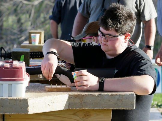 Eric Keller, 15, of Gladbrook, Iowa, prepares bullets during a Tama County Young Guns class at the Izaak Walton Shooting Facility in Toledo, Iowa, on April 14, 2016. After three accidental shootings involving minors in Tama County, two of them fatal, residents say they are not about to change their way of life and the importance they place on gun ownership. Membership in this 4-H Club group that promotes gun safety and marksmanship has gone up since the shootings.