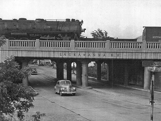 A Baltimore & Ohio freight train chugs along the elevated track in Elmira in this undated photo.