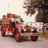 The gas tank of a 1919 fire truck was decorated with ornate art after it was restored.