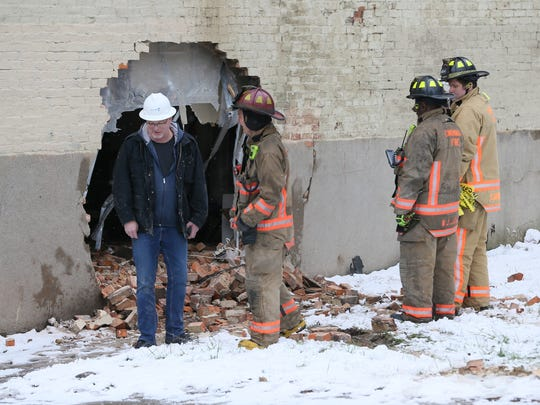 Cincinnati emergency responders work at a residence that had an unwelcome visitor Saturday afternoon. An SUV crashed into the home on Vine Street.