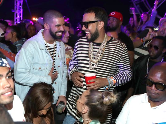 Rappers Drake (L) and French Montana attend The Levi's Brand Presents NEON CARNIVAL with Tequila Don Julio on April 15, 2017 in Thermal, California.
