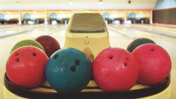 Bowling balls on ball return Bowling balls on ball return