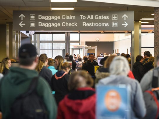 Passengers fill the hallways of the St. Cloud Regional Airport for a flight to Arizona on Wednesday, Dec. 27, in St. Cloud.