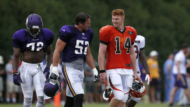 Vikings outside linebacker Chad Greenway and Bengals quarterback Andy Dalton laugh as they walk between fields during practice on Aug. 10. Both teams had plenty of eyes on them this week.