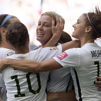 Abby Wambach celebrates her goal with her teammates during the first half of a FIFA Women's World Cup match against Nigeria on June 16.