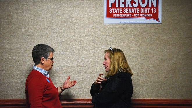 Democratic candidates for the South Dakota House of Representatives Karen Soli, left, and Ann Tornberg, right, visit during the South Dakota Democratic Party's Election Night event Tuesday, Nov. 8, 2016, at the Holiday Inn Sioux Falls City Centre in downtown Sioux Falls.