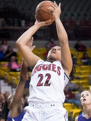 New Mexico State forward Tyler Ellis goes up strong