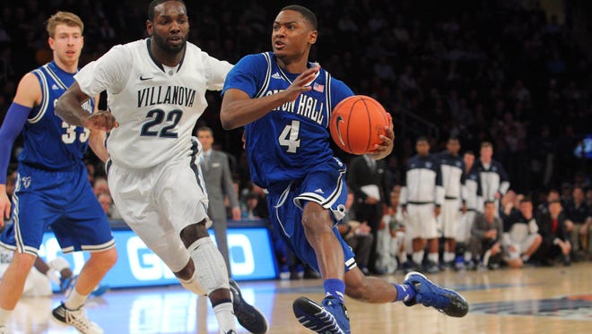 Seton Hall's Sterling Gibbs, right, drives past Villanova's JayVaughn Pinkston on Thursday in the second round of the Big East tournament.