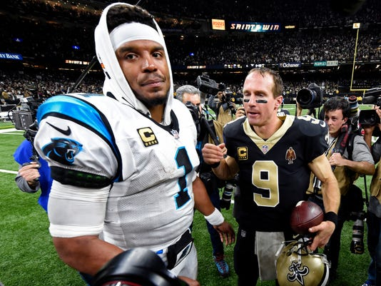 New Orleans Saints quarterback Drew Brees (9) greets Carolina Panthers quarterback Cam Newton (1) after their NFL wild card playoff football game in New Orleans, Sunday, Jan. 7, 2018. The Saints won 36-21. (AP Photo/Bill Feig)