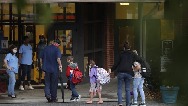 Students arrive to Dallas Elementary School for the first day of school on Monday, Aug. 3, 2020, in Dallas, Ga.