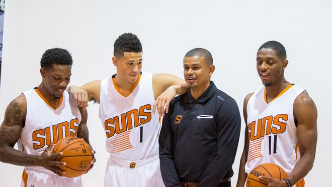 Sep 26, 2016: (From left) Phoenix Suns guard Eric Bledsoe , guard Devin Booker , head coach Earl Watson and guard Brandon Knight pose for a portrait during media day at Talking Stick Resort Arena.