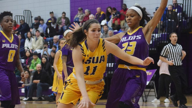 LSU of Alexandria's Katie Lemieux (11) goes for 2 against LSU of Shreveport Wednesday, Jan. 31, 2018 at the Fort on the LSUA campus.