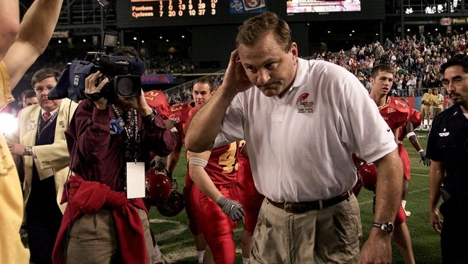 Iowa State head coach Dan McCarney wipes water off himself after receiving a victory bath in an Insight.com Bowl win over Pittsburgh on Dec. 28, 2000 in Phoenix.