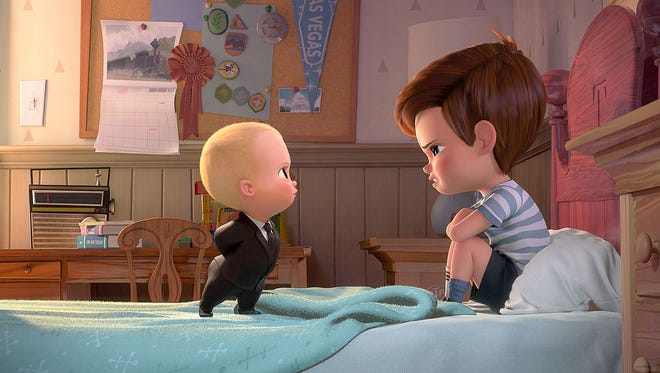"Boss Baby (voiced by Alec Baldwin) tries to convince Tim (voiced by Miles Bakshi) that they must cooperate in ""The Boss Baby."""
