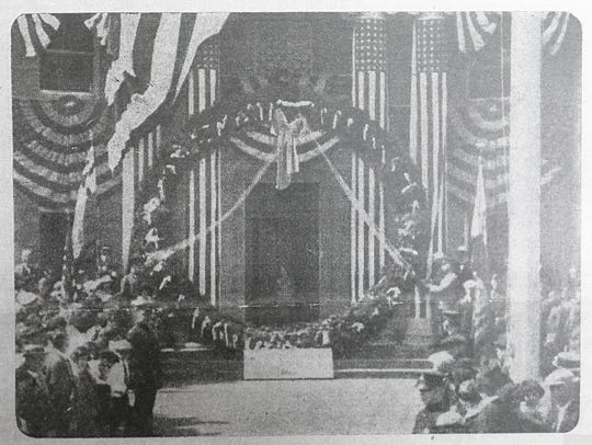 Old newspaper clipping of a ceremony recognizing the