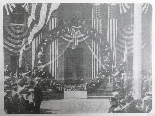 Old newspaper clipping of a ceremony recognizing the remains of the unknown Revolutionary War soldier at the Tuckahoe Town Hall during the 1920's.