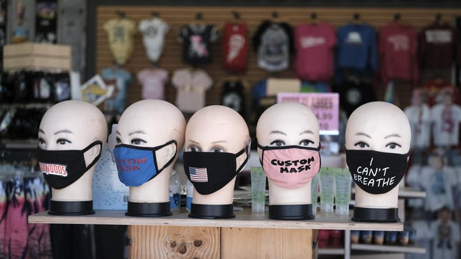 Facial masks are displayed at a shop at Venice Beach in Los Angeles, Friday, July 3, 2020.