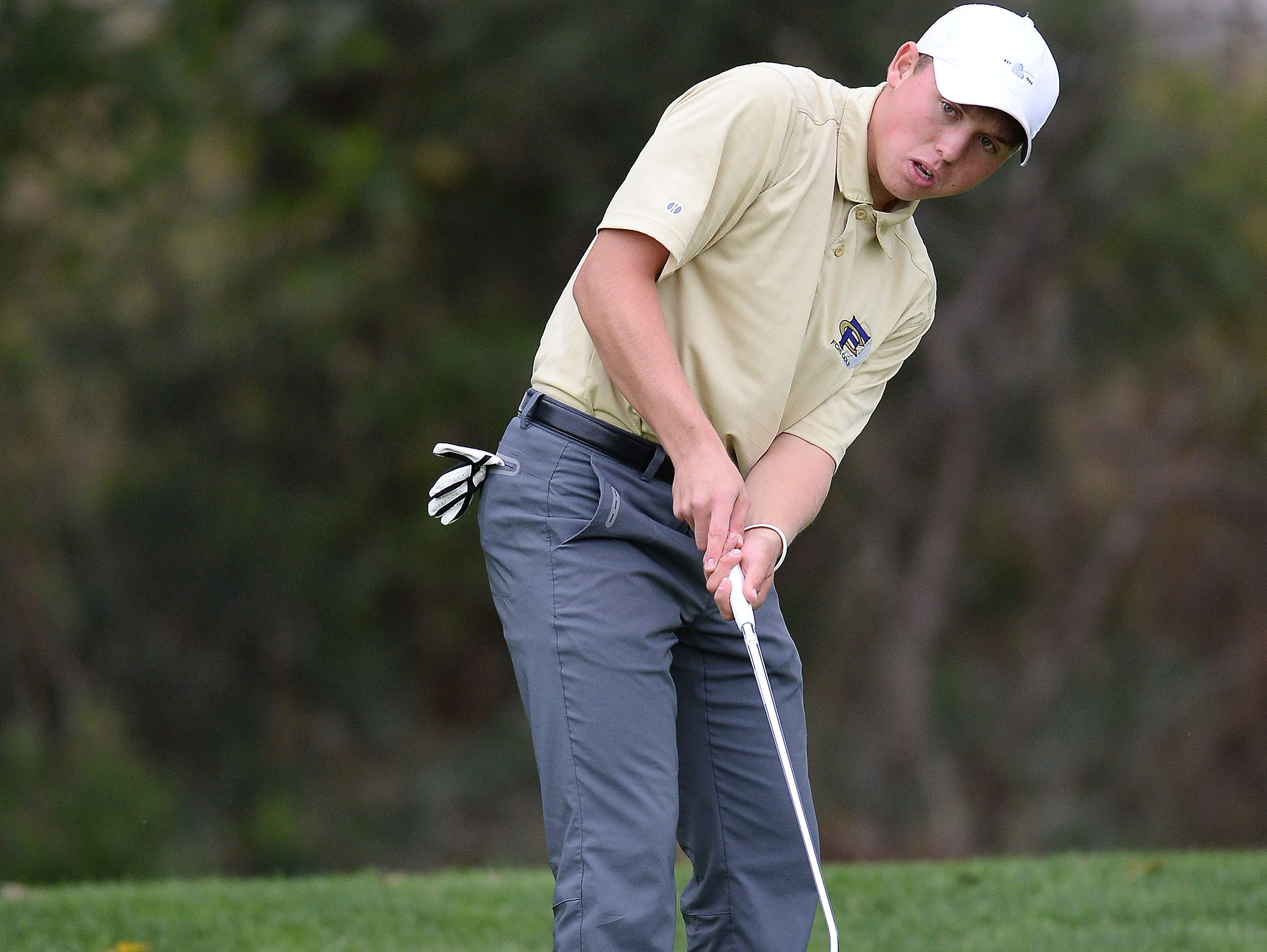 Fort Collins High School senior Hunter Paugh putts during the Class 5A state golf tournament at Fort Collins Country Club on Tuesday, October 6, 2015.