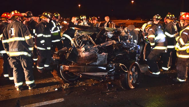 Medics and firefighters respond to a crash Wednesday night, Dec. 23, 2015, on East Street that killed three people.