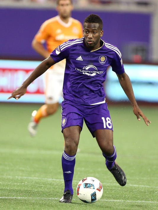 Orlando City's Kevin Molino moves the ball during an MLS soccer game against the Houston Dynamo in Orlando, Fla., Friday, July 8, 2016. (Stephen M. Dowell/Orlando Sentinel via AP)