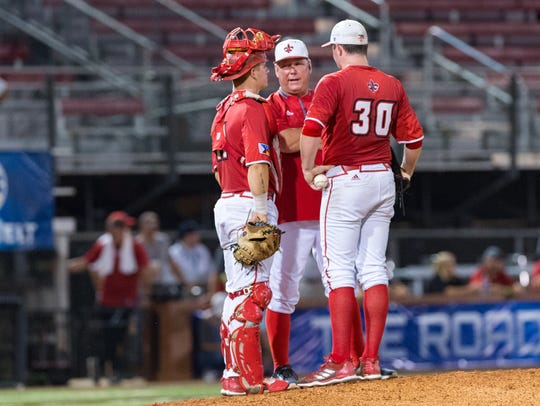UL coach Tony Robichaux visits on the mound during last season's Sun Belt Tournament with Hogan Harris (30), one of five key Ragin' Cajuns gone after 2018.