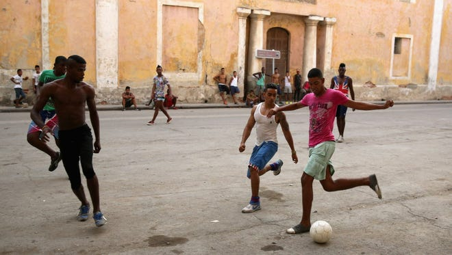 This photo from 2015 shows kids playing soccer on the street in Havana, Cuba.