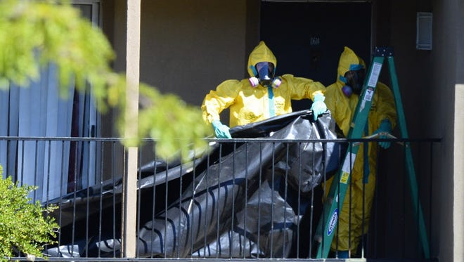 A hazardous material crew on Friday cleans up the apartment where Ebola patient Thomas Eric Duncan was staying in Dallas.