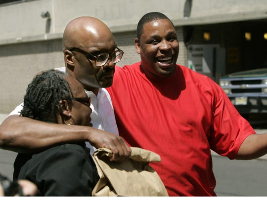 Byron Halsey, center, walks with arms around his brother James and his mother Eloise outside the Union County Jail in Elizabeth in 2007.