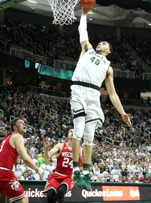 Michigan State Spartans guard Denzel Valentine (45) drives to the basket against the Wisconsin Badgers during the second half of a game at Jack Breslin Student Events Center.