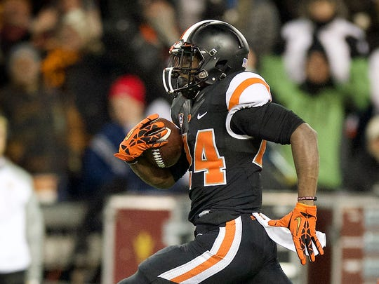 Oregon State tailback Storm Woods (24) scores a touchdown