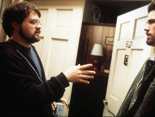 Director Kevin Smith, left, works with actor Ben Affleck