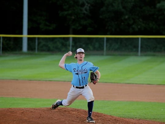 Tryg Hanson delivers a pitch for the Sauk Rapids American