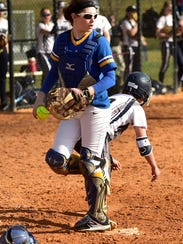 Waynesboro catcher Chelsea Cover looks off other runners