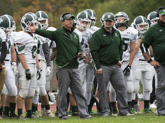 St. Johnsbury head coach Rich Alercio directs during
