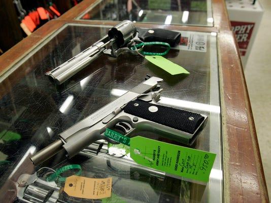 -ESTBrd_05-06-2014_Daily_1_A005~~2014~05~05~IMG_AP_handguns.jpg_1_1_7O791FJ9.jpg