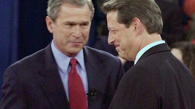 Texas Gov. George W. Bush greets Vice President Al Gore at Washington University in St. Louis on Oct. 17, 2000.