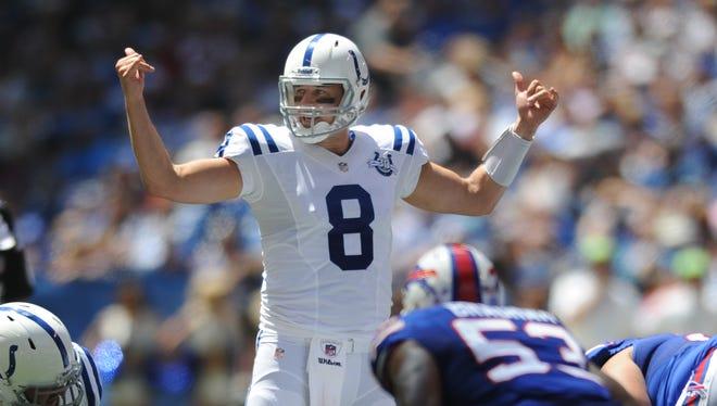 FILE -- Colts QB Matt Hasselbeck calls a play at the line of scrimmage in the 2013 preseason.